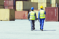 Workers walking near cargo containers - CAIF07673