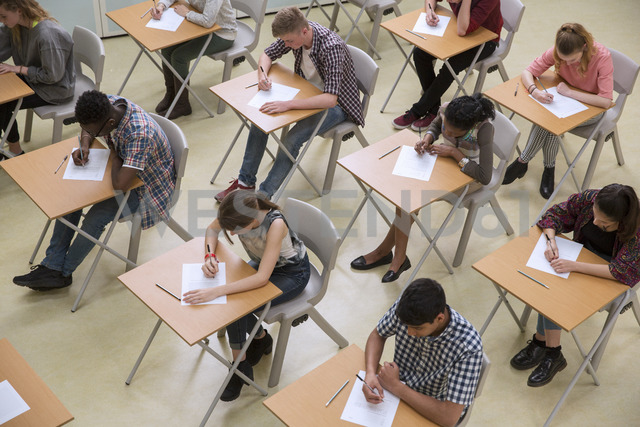 Elevated view of students writing their GCSE exam - CAIF07700