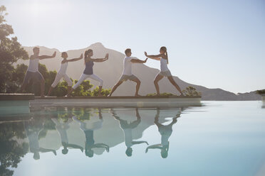 People practicing tai chi poolside - CAIF07742