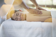 Woman receiving massage at spa - CAIF07778