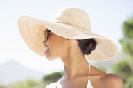 Woman wearing sun hat outdoors - CAIF07808