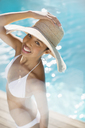Portrait of smiling woman at poolside - CAIF07835
