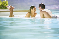 Couple relaxing in swimming pool - CAIF07841