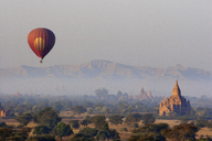 View of Htilominlo Temple and hot air balloon against sky - CAVF01414