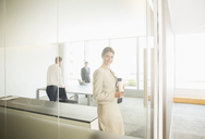 Businesswoman smiling in office - CAIF08002