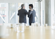 Businessmen talking in meeting - CAIF08029