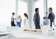 Business people talking in restaurant - CAIF08038
