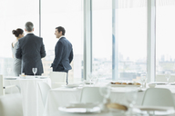 Business people talking in restaurant - CAIF08041