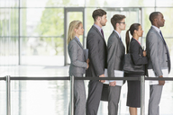 Business people waiting in line - CAIF08098