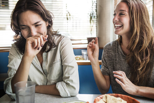 Happy women sitting in restaurant - CAVF01702