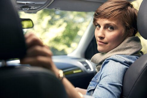 Portrait of woman sitting in car - CAVF02179