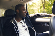 Man looking away while traveling in car - CAVF02185
