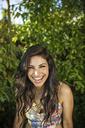 Portrait of happy woman in backyard - CAVF02281