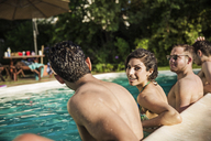 Portrait of woman enjoying with friends in pool - CAVF02299