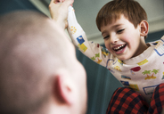 Child playing with father at home - CAVF02548