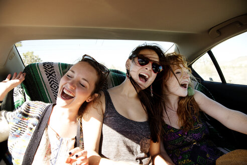 Happy friends traveling in car - CAVF02752