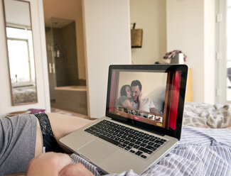 Couple video calling on bed at home - CAVF02866