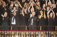 Enthusiastic audience clapping in theater balcony - CAIF08119