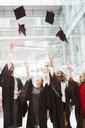 Graduates tossing caps in air - CAIF08179