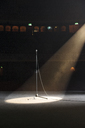Microphone in spotlight on empty theater stage - CAIF08227