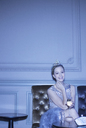Portrait of well dressed woman wearing tiara and drinking champagne - CAIF08254