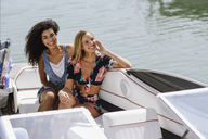 Portrait of two happy young women on a boat - JSMF00117