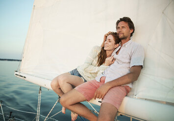 Couple relaxing while traveling in yacht - CAVF03945