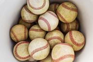 Overhead view of baseballs in bucket - CAVF04020