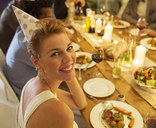 Woman smiling at birthday party - CAIF08470