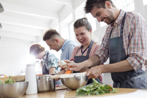 Couple enjoying cooking class in kitchen - CAIF08755