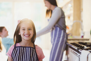 Portrait enthusiastic girl with toothy smile in kitchen - CAIF08887
