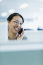 Smiling businesswoman talking on telephone in office - CAIF08983