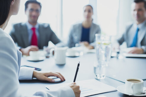 Businesswoman leading meeting in conference room - CAIF08986