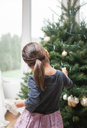 Toddler girl decorating Christmas tree - CAIF09223