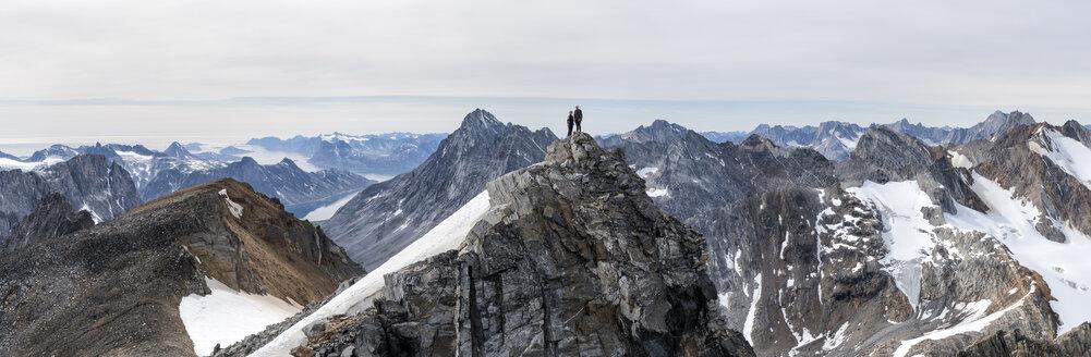 Greenland, Sermersooq, Kulusuk, Schweizerland Alps, two mountaineers on summit - ALRF00947
