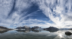 Greenland, Sermersooq, Kulusuk, Schweizerland Alps, mountains and clouds reflecting in water - ALRF01007