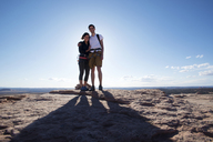 Portrait of happy couple standing on mountain against sky - CAVF04139