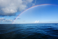 Idyllic view of rainbow over sea - CAVF04292
