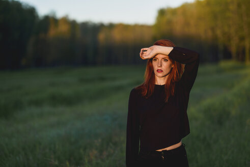 Portrait of redheaded young woman  in nature at sunset - JSMF00121
