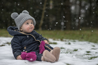 Portrait of baby girl watching snowflakes for the first time - LBF01842