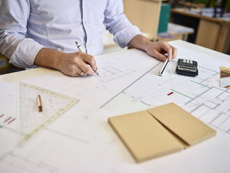 Architect working on construction drawing - CVF00284