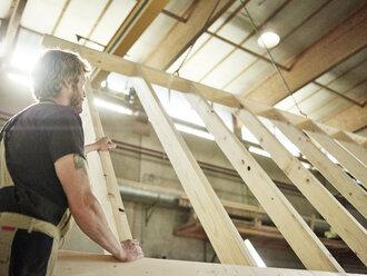Carpenter holding wooden construction - CVF00287