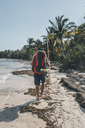 Cuba, Cienaga de Zapata, Backpacker walking on the beach, rear view - GUSF00530