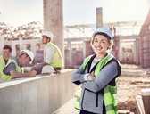 Portrait confident female construction worker at construction site - CAIF09302