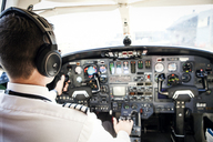 Rear view of pilot driving airplane - CAVF04571