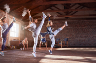 Young hip hop dancers with powder dancing in studio - CAIF09524