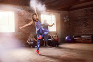 Young hip hop dancer with powder dancing in studio - CAIF09530