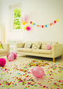 Birthday sign, balloons and confetti in living room - CAIF09554