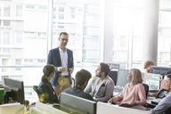 Businessman leading meeting in office - CAIF09767