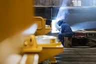 Welder using welding torch in steel factory - CAIF09833
